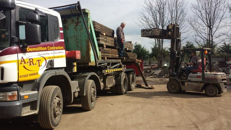 Father ( John Thurlby ) and son ( Adam Thurlby ) loading the lorry.: Swipe To View More Images